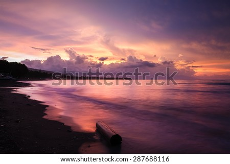 Vibrant tropical sunset at Bali indonesia - stock photo
