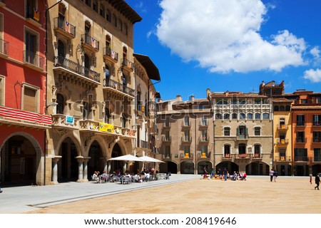 VIC, SPAIN - JUNE 1, 2014: Day view of Placa Mayor with restorains in Vic, Catalonia