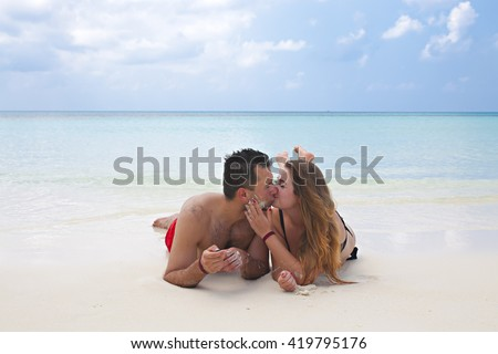 Victor and Monika are enjoying their time on the beach of Kuredu, Maldives - stock photo