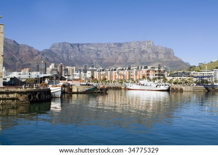 Victoria and Alfred Waterfront harbour and Table Mountain in Cape Town, South Africa - stock photo