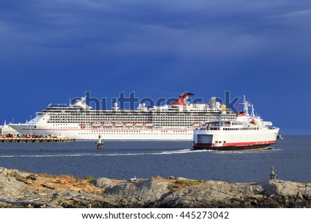 VICTORIA, BC, CANADA - JUN 21 2016. Cruise ship in Victoria. Each year hundreds of cruise ships docks in for a day or two. Victoria's charm and beauty has a lot to offer for any world traveler.