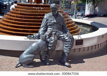 VICTORIA BC CANADA JUNE 23 2015: A sculpture of an old flyfisherman and his trusty companion-his dog Shaker by Nathan Scott  - stock photo
