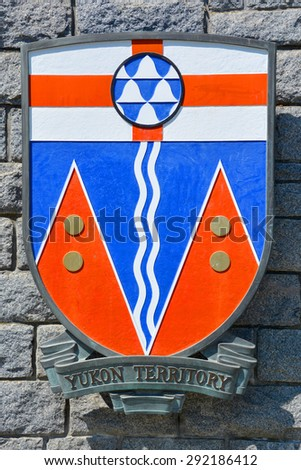 VICTORIA BC CANADA JUNE 22 2015: Coat of arms of Yukon Territory. Yukon the  westernmost and smallest of Canada's three federal territories. Whitehorse is the territorial capital and Yukon's only city - stock photo