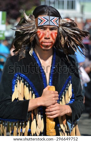 VICTORIA BC CANADA JUNE 24 2015: Native Indian man in traditional costume. First Nations in BC constitute a large number of First Nations governments and peoples in the province of British Columbia - stock photo