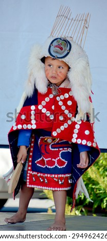 VICTORIA BC CANADA JUNE 24 2015: Unidentified Native Indian child in traditional costume. First Nations in BC constitute a large number of First Nations governments and peoples in the province of BC - stock photo