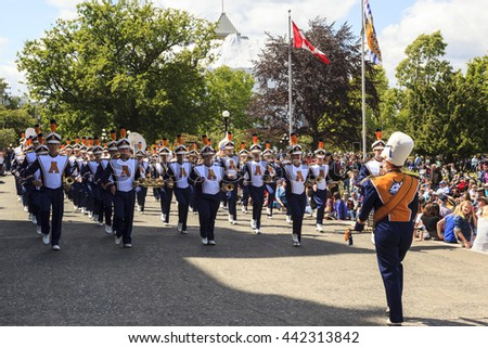 VICTORIA,BC,CANADA-MAY 22,2016: Battle of  Marching Bands from Canada and USA in the Victoria Day in front of Parliament House. This is Victoria's largest parade, attracting well over 100,000 people..