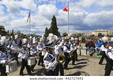VICTORIA,BC,CANADA-MAY 22,2016: Battle of Marching Bands from Canada and USA in the Victoria Day in front of Parliament House. This is Victoria's largest parade, attracting well over 100,000 people.. - stock photo