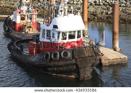 VICTORIA, BC, CANADA - MAY 7 2016: Classic tug boat are common vassals in the pictures Victoria. Those ships are for truism and plays an important part in the industry. - stock photo