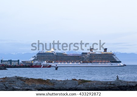 VICTORIA, BC, CANADA - MAY 21 2016. Cruise ship in Victoria. Each year hundreds of cruise ships docks in for a day or two. Victoria's charm and beauty has a lot to offer for any world traveler.  - stock photo