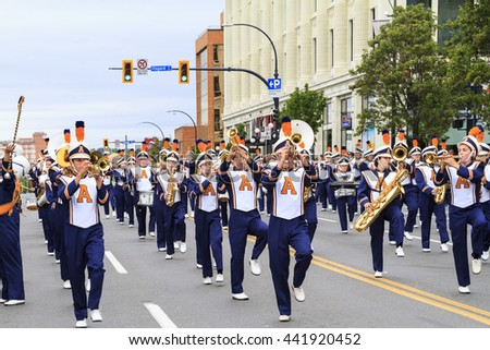 VICTORIA,BC,CANADA-MAY 23,2016: Marching Bands from Canada and USA in the Victoria Day parade along Douglas Street. This is Victoria's largest parade, attracting well over 100,000 people.. - stock photo