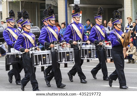 VICTORIA,BC,CANADA-MAY 23,2016: Marching Bans from Canada and USA in the Victoria Day parade along Douglas Street. This is Victoria's largest parade, attracting well over 100,000 people.. - stock photo