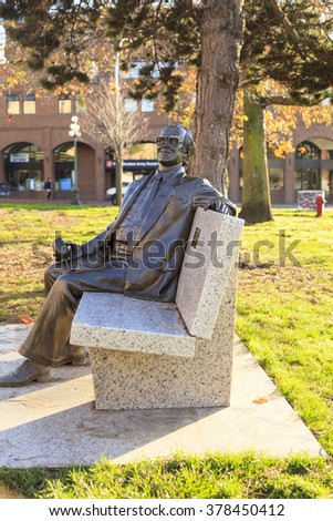 VICTORIA BC CANADA NOV 8 2014: Statue of Michael Collard Williams (1930 - 2000) was a self-made millionaire and high profile community member in Victoria society since his arrival here in 1958. - stock photo