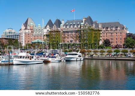 VICTORIA, BRITISH COLUMBIA, CANADA - JULY 7: The Fairmont Empress Hotel facade on July 7, 2013 in Victoria, British Columbia, Canada. It is among the oldest and most prominent hotel in Victoria. - stock photo