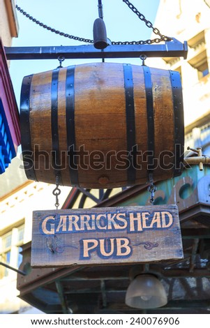 VICTORIA BRITISH COLUMBIA CANADA  NOV 27 2014:   Traditional pub sign, the pubs are one of the focal point of the community and in Victoria also adding to the local flora. - stock photo