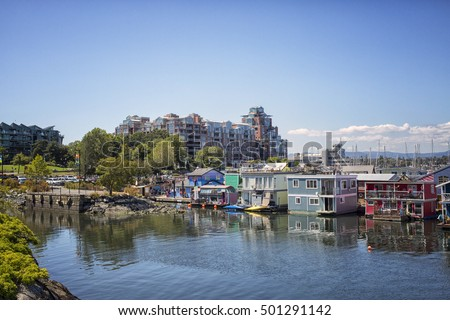 VICTORIA,CANADA-AUG 4,2016:Floating Home Village with colorful houseboats at Inner Harbor, Victoria British Columbia Canada Pacific Northwest. Area has floating homes, boats, piers, and restaurants.