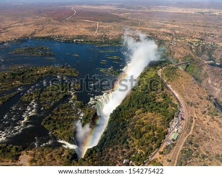 Victoria Falls (or Mosi-oa-Tunya - the Smoke that Thunders) waterfall in southern Africa on the Zambezi River at the border of Zambia and Zimbabwe. Aerial Image taken from helicopter flight - stock photo