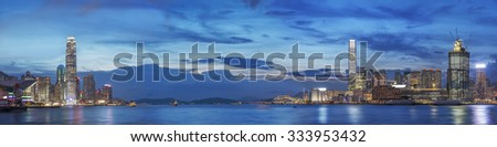Victoria Harbor of Hong Kong at dusk - stock photo