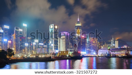 Victoria Harbor of Hong Kong City at night - stock photo