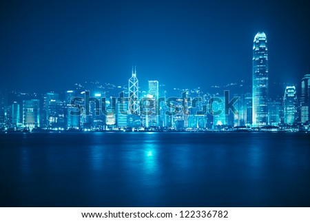 victoria harbour skyline at night in Hong Kong - stock photo