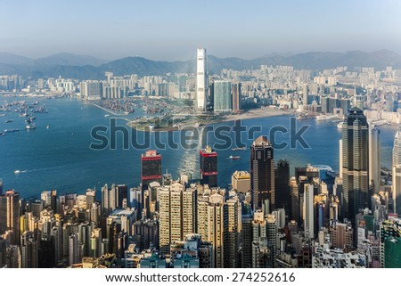 VICTORIA, HONGKONG - JAN 9, 2010: Hong Kong view from Victoria Peak to the bay and the skyscraper in sunset in Victoria, Hongkong. - stock photo
