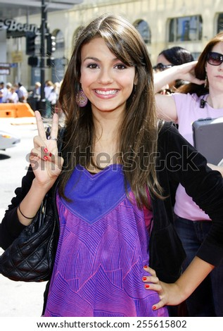 """Victoria Justice attends the World Premiere of """"Nancy Drew"""" held at the Grauman's Chinese Theatre in Hollywood, California, on June 9, 2006.  - stock photo"""