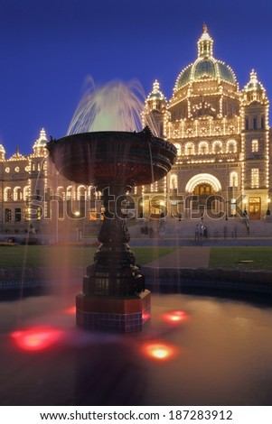 Victoria, Parliament Building Night. The parliament building and fountain at night in Victoria, British Columbia, Canada.  - stock photo