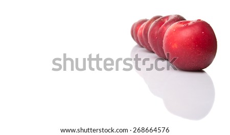 Victoria plum or red plum over white background