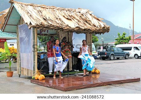 VICTORIA, SEYCHELLES-DEC.13, 2014:  Dancers and musicians welcome cruise ship passengers to Mahe Island in the Seychelles. - stock photo