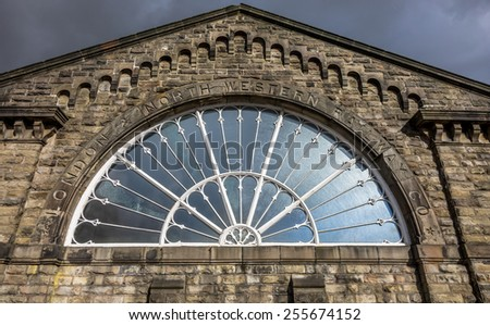 Victorian Fan-shaped cast iron window of the Buxton Midland Railway. - stock photo
