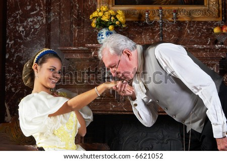 """Victorian gentleman kissing the hand of a lady in the old-fashioned way. Shot in Castle """"Den Brandt"""" in Antwerp, Belgium (signed property release for the castle interiors) - stock photo"""