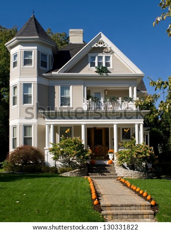 Victorian House in Fall - stock photo