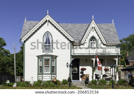 Victorian house with a gingerbread roof decoration - stock photo