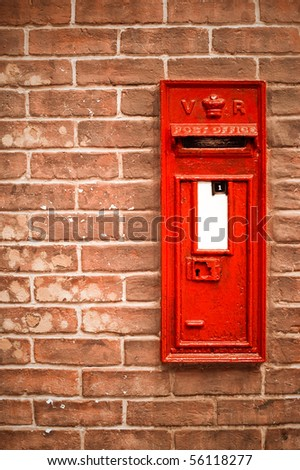 victorian mail box abstract against a brick wall with blank white space for copy - stock photo