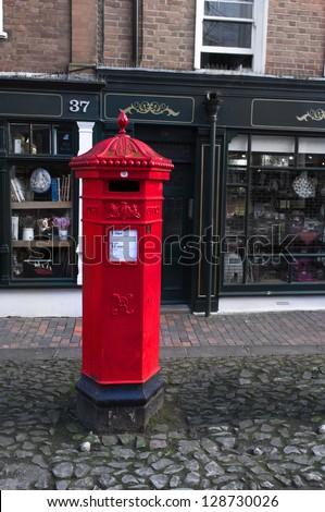Victorian post box in the pantiles, Tunbridge Wells, UK - stock photo