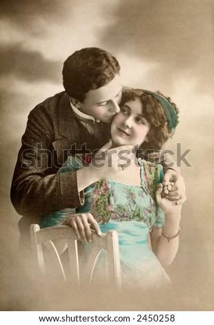Victorian romance - couple in love - circa 1913 hand-tinted photograph - stock photo