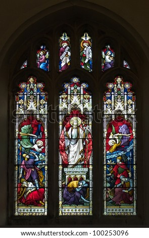 Victorian stained glass window picturing the resurrection of Christ - stock photo