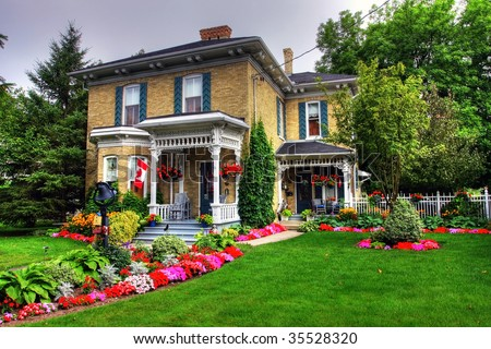 Victorian style cottage and garden in Goderich, Canada - stock photo