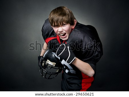Victorious boy after winning american football game - stock photo