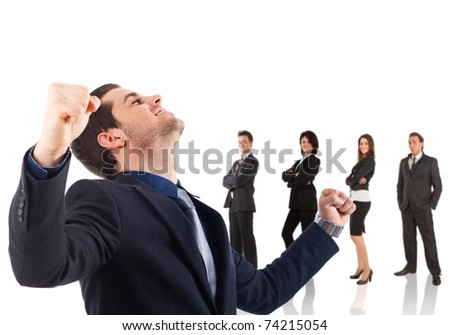 Victorious businessman with his team in the background, isolated over white