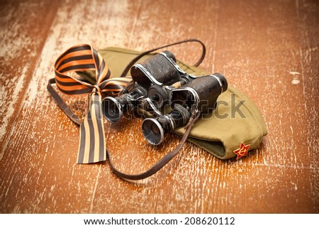 Victory Day on May 9. Military binoculars, field cap, George Ribbon. retro Style. 70 Years of Victory - stock photo