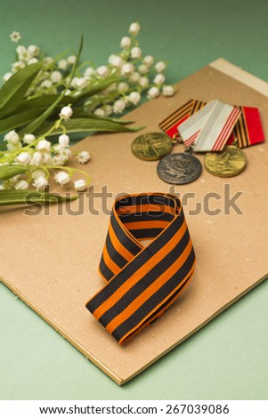 Victory Day. St. George ribbon, medals and lilies of valley - stock photo