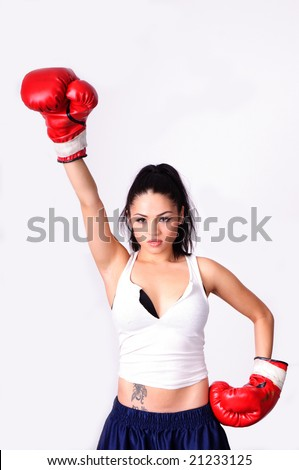 victory stance of female boxer with red gloves isolated over white background