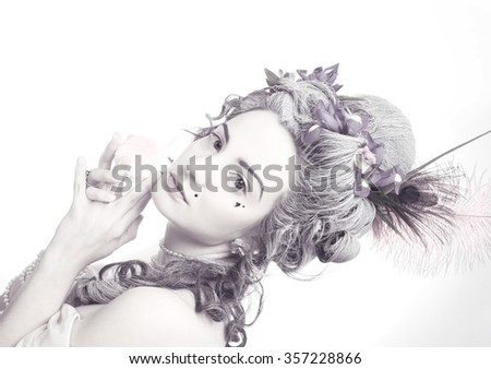 Victotian lady. Young woman in eighteenth century image posing with sweets