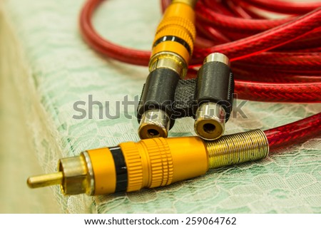 Video cables on red. HDMI & composit. - stock photo