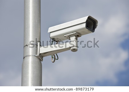 Video camera on a lamppost - stock photo