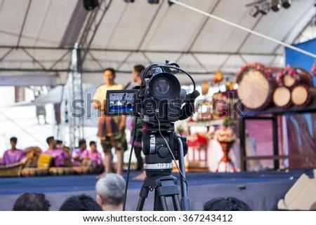 Video camera, scene on background - stock photo