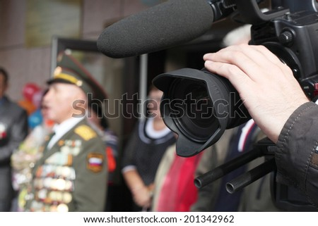 video camera shooting an event - stock photo