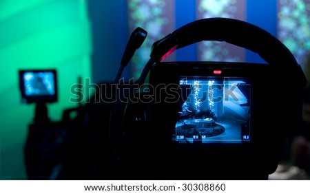 Video camera viewfinder - recording in TV studio - Talking To The Camera - stock photo