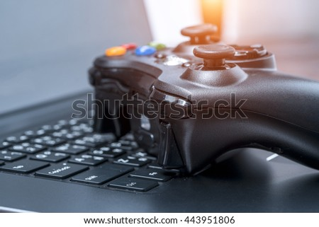 Video game controller isolated on the laptop. - stock photo