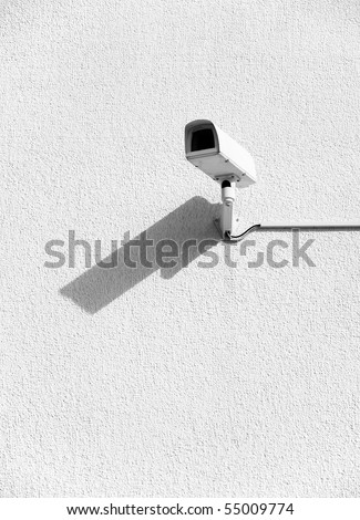 Video surveillance cameras on a wall.